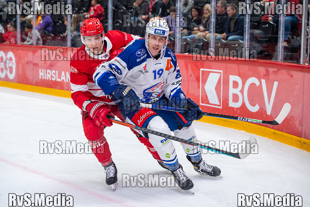 LAUSANNE, SWITZERLAND - OCTOBER 01: Floran Douay #18 of Lausanne HC vies with Reto Schappi #19 of ZSC Lions during the Swiss National League game between Lausanne HC and ZSC Lions at Vaudoise Arena on October 1, 2021 in Lausanne, Switzerland. (Photo by Monika Majer/RvS.Media)