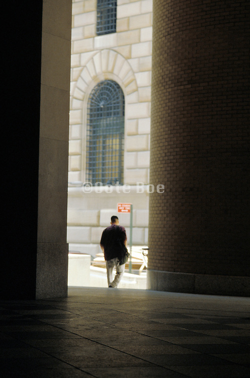 Man leaving a building