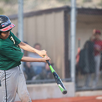 Damian Dedrick gets a base hit for the Athletics against the Angels in the Pee Wee Reese league at Ford Canyon Park Friday, May 31 in Gallup.