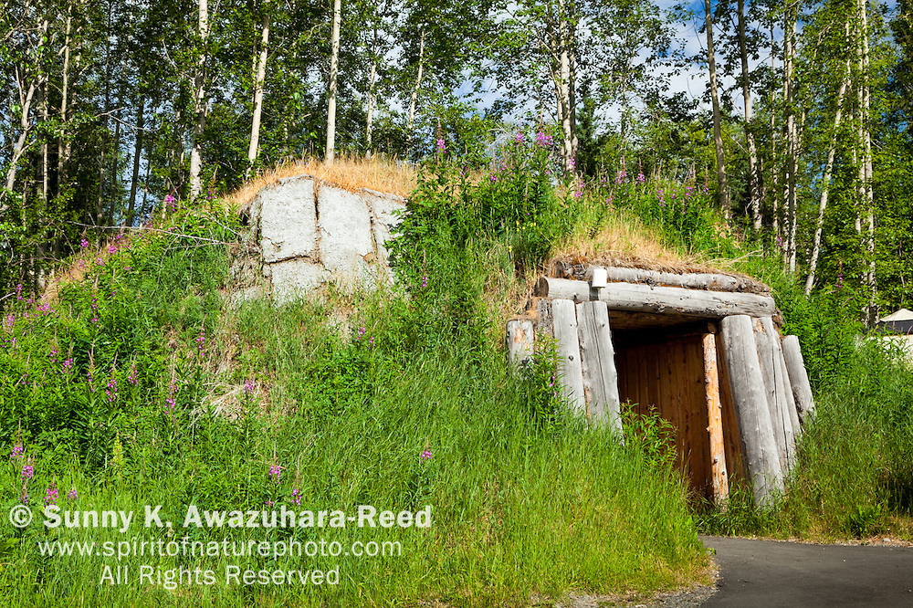 Traditional housing, Ulax at Aleut and Alutiiq Village site at Alaska Native Heritage Center, Anchorage, Southcentral Alaska, Summer.