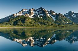 Unnamed mountain peaks between Tree Mountain (not pictured) and Mount Case (right) are reflected in the Adams Inlet of Glacier Bay National Park and preserve in southeast Alaska.