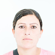Haifaa Koji Khedr a 28 year old Yazidi from Rambusi, northern Iraq. <br /> <br /> This is a series of portraits of Yazidi refugees who were stranded since April 2016 in Greece.  All of them survived the Yazidi Genocide by ISIS in August 2014 and most of them have lost family members.