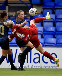 Liverpool Women's Rhiannon Roberts and Manchester United Women's Kirsty Hanson (top) battle for the ball during the Continental Tyres Cup, Group Two North match at Prenton Park, Birkenhead.
