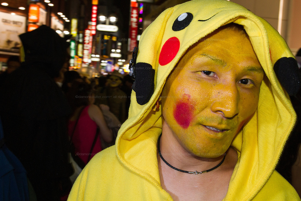 A man dressed in a Pokemon costume for Halloween in Shibuya, Tokyo, Japan. Friday October 31st 2014