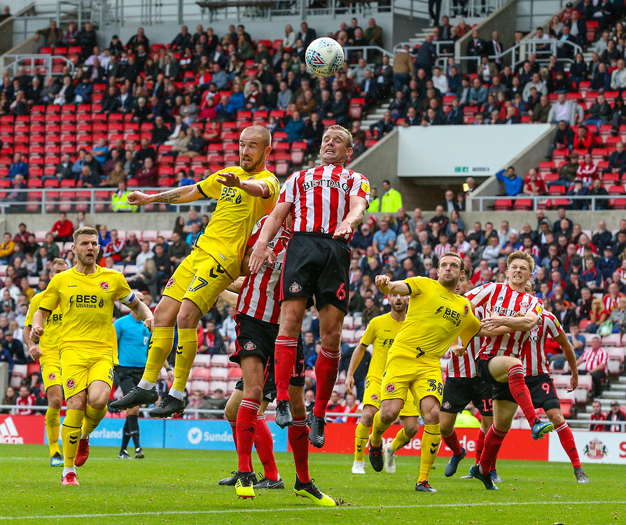 Fleetwood Town's Paddy Madden competes in the air with Sunderland's Lee Cattermole<br /> <br /> Photographer Alex Dodd/CameraSport<br /> <br /> The EFL Sky Bet League One - Sunderland v Fleetwood Town - Saturday September 8th 2018 - Stadium of Light - Sunderland<br /> <br /> World Copyright © 2018 CameraSport. All rights reserved. 43 Linden Ave. Countesthorpe. Leicester. England. LE8 5PG - Tel: +44 (0) 116 277 4147 - admin@camerasport.com - www.camerasport.com