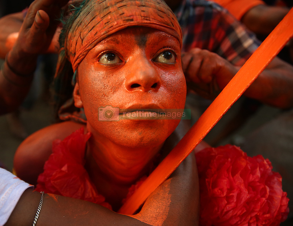 April 13, 2018 - Dhaka, Bangladesh - Hindu devotees dance as they take part in a festival called Lal Kach (Red Glass) during the last day of the Bangla month.The Lal Kach festival is well known for the local community for more than hundred years. The Hindu youth and men paint themselves with red color and attend a procession holding swords as they show power against evil and welcome the Bengali New Year 1425. (Credit Image: © Mushfiqul Alam/NurPhoto via ZUMA Press)