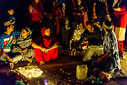 """12th November 2015, New Delhi, India. A man receiving the blessings of the divine from a Sufi 'pir' (master) reacts at a shrine dedicated to Djinn worship in the ruins of Feroz Shah Kotla in New Delhi, India on the 12th November 2015<br /> <br /> PHOTOGRAPH BY AND COPYRIGHT OF SIMON DE TREY-WHITE a photographer in delhi<br /> + 91 98103 99809. Email: simon@simondetreywhite.com<br /> <br /> People have been coming to Firoz Shah Kotla to pray to and leave written notes and offerings for Djinns in the hopes of getting wishes granted since the late 1970's. Jinn, jann or djinn are supernatural creatures in Islamic mythology as well as pre-Islamic Arabian mythology. They are mentioned frequently in the Quran  and other Islamic texts and inhabit an unseen world called Djinnestan. In Islamic theology jinn are said to be creatures with free will, made from smokeless fire by Allah as humans were made of clay, among other things. According to the Quran, jinn have free will, and Iblīs abused this freedom in front of Allah by refusing to bow to Adam when Allah ordered angels and jinn to do so. For disobeying Allah, Iblīs was expelled from Paradise and called """"Shayṭān"""" (Satan).They are usually invisible to humans, but humans do appear clearly to jinn, as they can possess them. Like humans, jinn will also be judged on the Day of Judgment and will be sent to Paradise or Hell according to their deeds. Feroz Shah Tughlaq (r. 1351–88), the Sultan of Delhi, established the fortified city of Ferozabad in 1354, as the new capital of the Delhi Sultanate, and included in it the site of the present Feroz Shah Kotla. Kotla literally means fortress or citadel."""