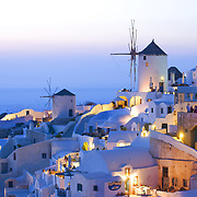 Iconic view of Oia village Santorini with windmills at sunset
