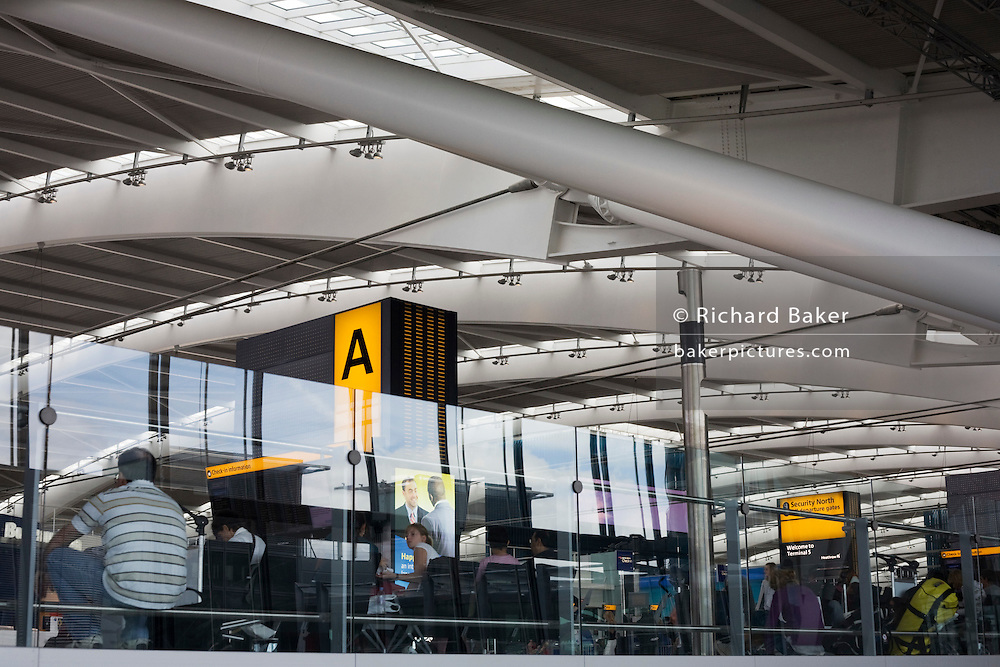 Interior of Heathrow Terminal 5's departures concourse and 50 ton rafters making T5 the largest free-standing building in UK