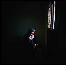 A woman is seen in Aytaroun, Southern Lebanon, Oct. 23, 2006. The village suffered significant damage during heavy fighting between Hezbollah and Israeli forces.