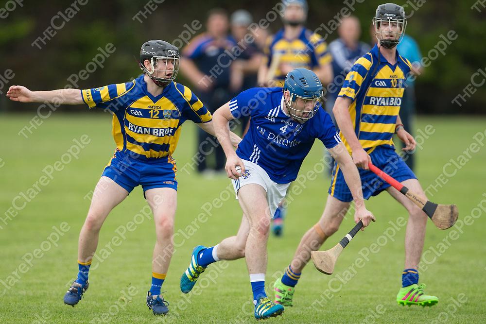 Parteen's Evan Higgins in action against Ruan's Brendan Lyons