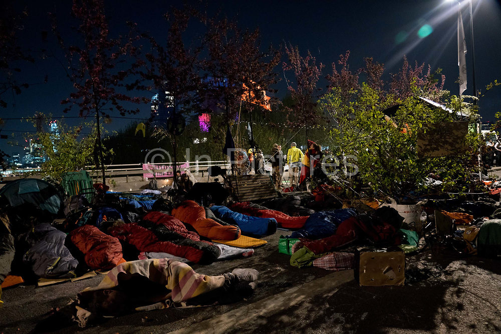 People sleeping out to maintain the occupation of Waterlook Bridge. Protesters on Waterloo Bridge, blocking the traffic in peaceful demonstration asking for the Government to act on climate change. Several roads were blocked across four sites in central London, by the Extinction Rebellion climate change protests, April 2019.