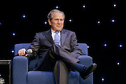 """President Bush during a corporate speaking engagement in San Antonio, Texas. George W. Bush served as the 43rd President of the United States from 2001-2009. He was transformed into a wartime President in the aftermath of the airborne terrorist attacks on September 11, 2001, facing the """"greatest challenge of any President since Abraham Lincoln."""""""