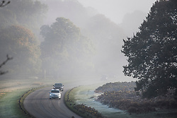 © Licensed to London News Pictures. 08/11/2019. London, UK. Traffic makes it's way through fog and frost at Richmond Park in west London on cold autumn morning. Parts of the north of England have experienced severe flooding following torrential rainfall. Photo credit: Ben Cawthra/LNP