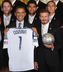U.S. President Barack Obama holds up a jersey given to him by LA Galaxy while welcoming members of the Major League Soccer champions including David Beckham (R) to the White House to honor their 2012 season and their MLS Cup victory in the East Room of the White House in Washington, DC, USA on May 15 2012. Photo by Olivier Douliery/ABACAPRESS.COM    320253_001 Washington Etats-Unis United States