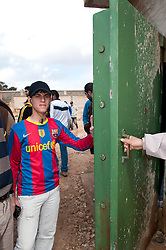 © under license to London News Pictures. 24/02/2011. A boy shows off the reinforced door at the entrance of one of the many prisons in at the Army Compound in the Libyan city of Benghazi. Opposition members say that four prisoners were found alive when they searched the prisons after they took control. Photo credit should read Michael Graae/London News Pictures