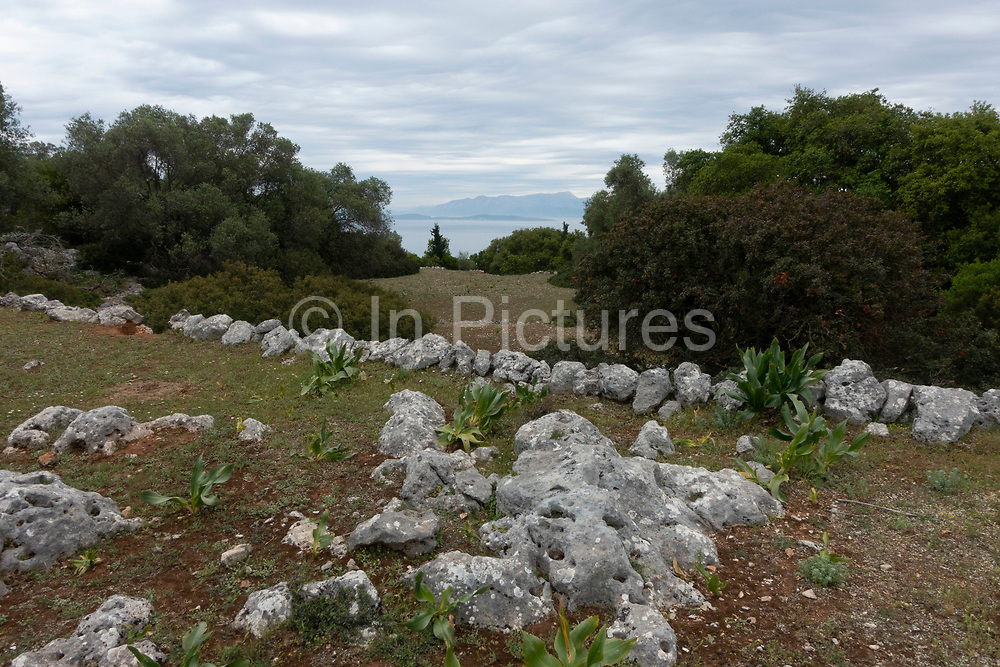 Ancient settlement site near Kioni, Ithaca, Greece. Ithaca, Ithaki or Ithaka is a Greek island located in the Ionian Sea to the west of continental Greece. Ithacas main island has an area of 96 square kilometres. It is the second-smallest of seven main Ionian Islands.