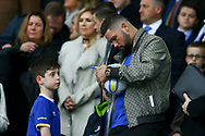WBC cruiserweight title holder and Everton fan boxer Tony Bellew signs a football for a young fan prior to kick off. Premier league match, Everton v West Bromwich Albion at Goodison Park in Liverpool, Merseyside on Saturday 11th March 2017.<br /> pic by Chris Stading, Andrew Orchard sports photography.