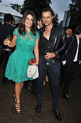 DANIELLA ISSA HELAYEL and GERRY DEVEAUX at the annual Serpentine Gallery Summer Party sponsored by Burberry held at the Serpentine Gallery, Kensington Gardens, London on 28th June 2011.