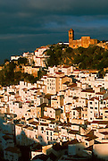 SPAIN, ANDALUSIA CASARES; a picturesque mountain village or 'pueblo blanco' near Estepona on the Costa del Sol; with castle on cliff above