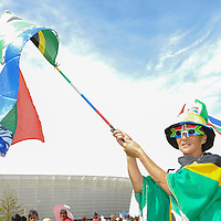 """A fan wears South African colors during the City of Cape Town hosted concert at the 45000 seater Cape Town Stadium called """"Nelson Mandela - A life Celebrated"""". Concert goers walked the Fan Walk, called the """"Walk of Remembrance"""" for today and placed flowers at a memorial wall outside the stadium. Nelson Mandela was the first democratically elected president of South Africa."""
