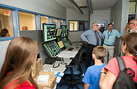 Visitors toured the control room following the grand opening of Belknap County's Corrections Facility on Thursday afternoon.  (Karen Bobotas/for the Laconia Daily Sun)