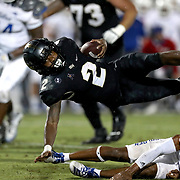 ORLANDO, FL - OCTOBER 03: Otis Anderson #2 of the Central Florida Knights leaps for a first down against the Tulsa Golden Hurricane at Bright House Networks Stadium on October 3, 2020 in Orlando, Florida. (Photo by Alex Menendez/Getty Images) *** Local Caption *** Otis Anderson