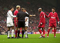 Photo. Glyn Thomas.<br /> Liverpool v Manchester United. Barclaycard Premiership.<br /> Anfield, Liverpool. 09/11/03.<br /> Manchester United's Ruud van Nistelrooy (L) is less than happy at being shown a yellow card and a confrontation ensues involving Liverpool's El-Hadji Diouf (second from R).