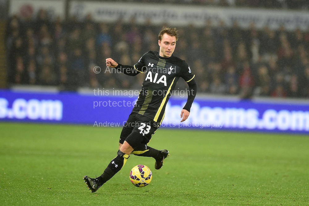 Christian Eriksen of Tottenham in action. Barclays Premier League match, Swansea city v Tottenham Hotspur at the Liberty Stadium in Swansea, South Wales on Sunday 14th December 2014<br /> pic by Andrew Orchard, Andrew Orchard sports photography.