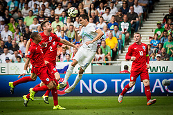 Branko Ilic of Slovenia and Gary Cahill, Ryan Bertrand and Wyne Roney of England during the EURO 2016 Qualifier Group E match between Slovenia and England at SRC Stozice on June 14, 2015 in Ljubljana, Slovenia. Photo by Grega Valancic