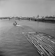 0804-06A.  tug boat pulling a log boom in Portland Harbor,  taken from the old Morrison Bridge.