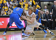 WICHITA, KS - JANUARY 18:  Guard Ron Baker #31 of the Wichita State Shockers reaches in for a loose ball against guard Manny Arop #3 of the Indiana State Sycamores during the first half on January 18, 2014 at Charles Koch Arena in Wichita, Kansas.  (Photo by Peter Aiken/Getty Images) *** Local Caption *** Ron Baker;Manny Arop