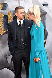 Charlie Hunnam and Poppy Delevingne (right) attending the European premiere of King Arthur at Cineworld Empire, Leicester Square, London. Photo credit should read: Doug Peters/EMPICS Entertainment