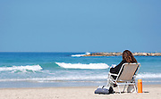 Israel, Tel Aviv, A sunny winter's day on the beach February 2009. Young woman relaxing