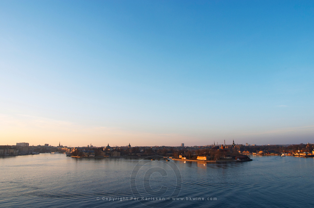 An evening view over Strommen Stockholm Strom with from left to right the Old Town Gamla Stan, Skeppsholmen, Kastellholmen Djurgarden and the straight leading out to the archipelago Stockholm, Sweden, Sverige, Europe