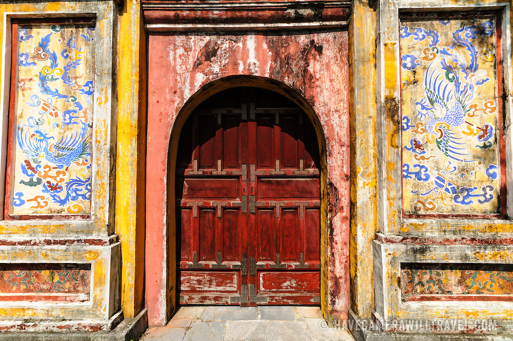 Door to the Dien Tho Residence at the Imperial City in Hue, Vietnam. A self-enclosed and fortified palace, the complex includes the Purple Forbidden City, which was the inner sanctum of the imperial household, as well as temples, courtyards, gardens, and other buildings. Much of the Imperial City was damaged or destroyed during the Vietnam War. It is now designated as a UNESCO World Heritage site.