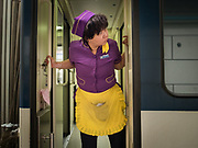 A train hostess looks for a food delivery in Lanzhou. Life in the train from Hong Kong to Urumqi, Xinjiang.