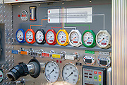 Row of dials on side of fire engine which help regulate the flow of water. Aquatennial Beach Bash Minneapolis Minnesota USA