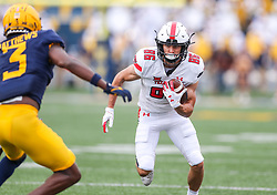 Oct 2, 2021; Morgantown, West Virginia, USA; Texas Tech Red Raiders wide receiver Dalton Rigdon (86) catches a pass and runs for extra yards during the first quarter against the West Virginia Mountaineers at Mountaineer Field at Milan Puskar Stadium. Mandatory Credit: Ben Queen-USA TODAY Sports