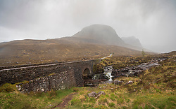 Bridge  in the rain at start of climb into Bealach na Ba pass on Applecross Peninsula  the North Coast 500 scenic driving route in northern Scotland, UK