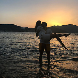 """Alessandra Ambrosio releases a photo on Twitter with the following caption: """"""""Endless summer love 💕"""""""". Photo Credit: Twitter *** No USA Distribution *** For Editorial Use Only *** Not to be Published in Books or Photo Books ***  Please note: Fees charged by the agency are for the agency's services only, and do not, nor are they intended to, convey to the user any ownership of Copyright or License in the material. The agency does not claim any ownership including but not limited to Copyright or License in the attached material. By publishing this material you expressly agree to indemnify and to hold the agency and its directors, shareholders and employees harmless from any loss, claims, damages, demands, expenses (including legal fees), or any causes of action or allegation against the agency arising out of or connected in any way with publication of the material."""