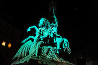 Berlin, Germany. Nikolaiviertel, Nikolai Quarter, is the reconstructed historical heart of the city. The statue of St. George Slaying the Dragon.