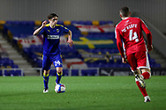 AFC Wimbledon midfielder George Dobson (24) dribbling and about to take on Gillingham FC midfielder Stuart O'Keefe (4)during the EFL Sky Bet League 1 match between AFC Wimbledon and Gillingham at Plough Lane, London, United Kingdom on 23 February 2021.
