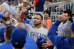 May 15, 2018 - Atlanta, GA, U.S. - ATLANTA, GA Ð MAY 15:  Cubs catcher Willson Contreras (40) gets high-fives from teammates after scoring a run in the 4th inning during the game between Atlanta and Chicago on May 15th, 2018 at SunTrust Park in Atlanta, GA. The Chicago Cubs defeated the Atlanta Braves by a score of 3 -2.  (Photo by Rich von Biberstein/Icon Sportswire) (Credit Image: © Rich Von Biberstein/Icon SMI via ZUMA Press)