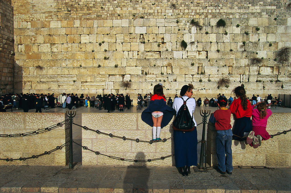 A family standing along the Western Wall.
