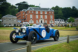 © Licensed to London News Pictures. 13/07/2015. Epsom, UK.  MARTIN EMMISON and ADRIAN BIGGS set off in their 1929 Riley Sports. The start of The Royal Automobile Club 1000 Mile Trial 2015 at Woodcote Park in Epsom, Surrey. The event, which starts and finishes at Woodcote Park, takes a fleet of over 40 classic cars from around the world, through a 1000 mile trial around the UK.  Photo credit: Ben Cawthra/LNP
