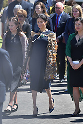The Duchess of Sussex (centre) wears a traditional Maori cloak called a Korowai as she arrives, at Te Papaiouru, Ohinemutu, in Rotorua, before a lunch in honour of Harry and Meghan, on day four of the royal couple's tour of New Zealand.