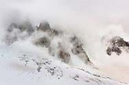 The Capucins and the Glacier du Geant in the fog, France / Les Capucins am Mont Blanc du Tacul und ein Abbruch des Glacier du Géant an einem nebligen und stürmischen Sommerabend im Mont Blanc Massif in der Nähe der Turiner Hütte