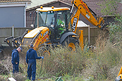 ©Licensed to London News Pictures 10/09/2020  <br /> Orpington, UK. Specialist search team officers on the site with a JCB digger. Police continue to search a traveller site in Orpington, South East London today after one of the biggest armed police operations in the UK. The site and local roads are under Met police control with a large cordon in place. Photo credit:Grant Falvey/LNP