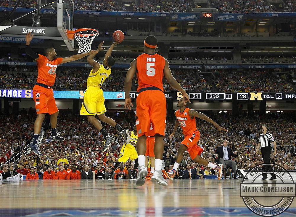 Michigan defeats Syracuse in the Final Four on Saturday April 6, 2013 in Atlanta, Georgia. Photos by Mark Cornelison | Staff
